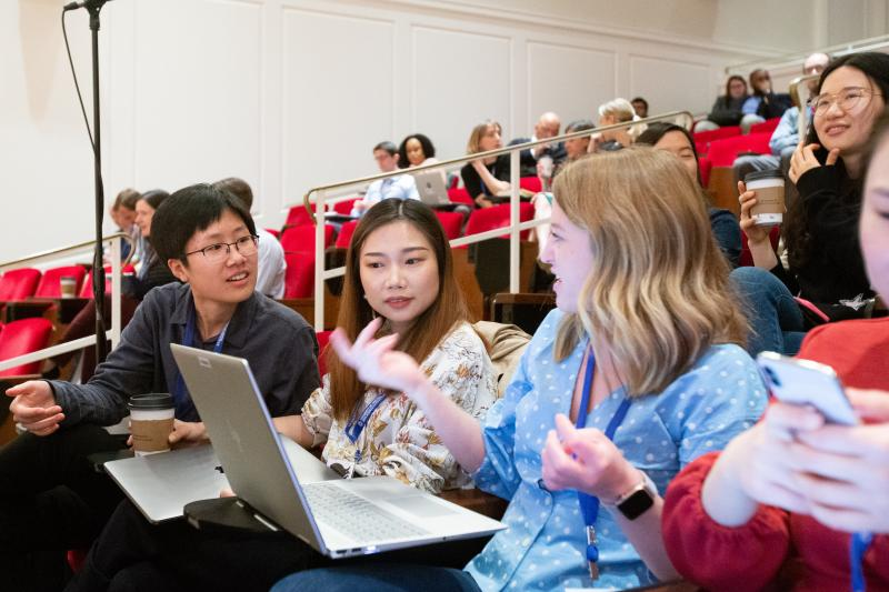 Women conversing in lecture hall