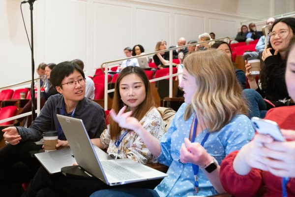 Women discussing in a lecture hall