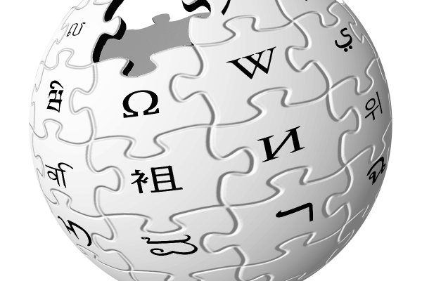 Wikipedia logo. Sphere of puzzle pieces with different letters or symbols on them.