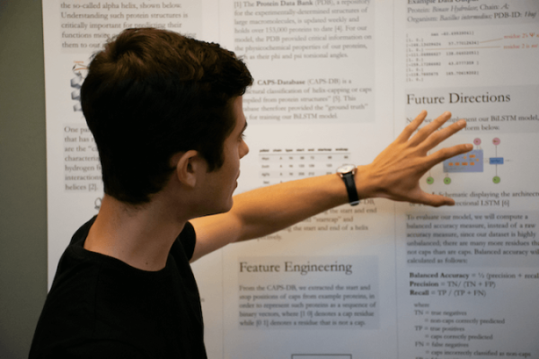 A student pointing to data