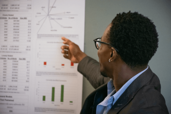 Man pointing to a data visualization